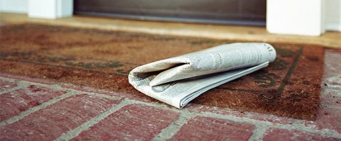 Newspeperonporch.jpg