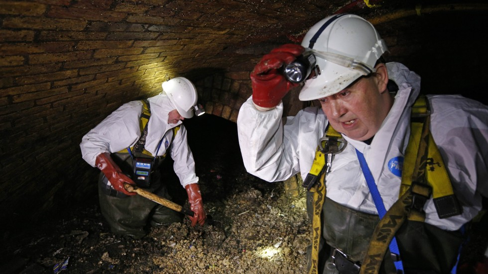 London sewer workers race to unclog giant pools of fatty
