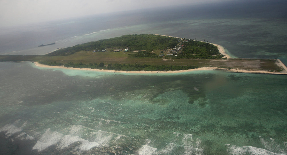 China has confirmed military installations on an artificial island near the disputed Spratly islands, posing yet another test for US overseas military, diplomatic and political influence