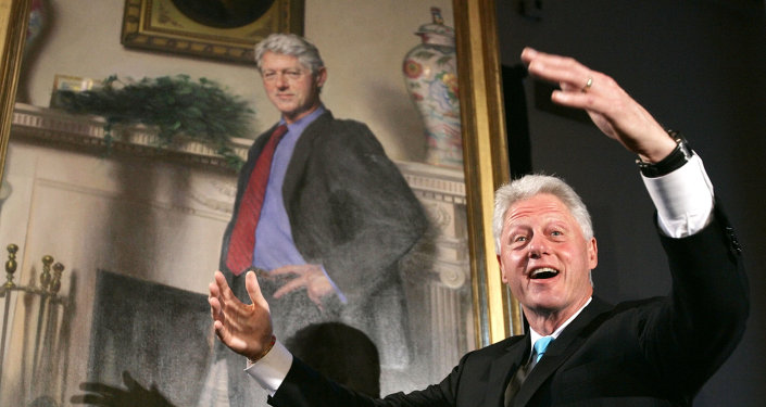 Former President Bill Clinton, gestures after the portraits of his wife Sen. Hillary Rodham Clinton and him were revealed