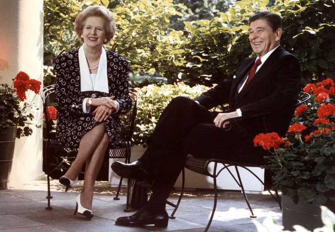 Former US President Ronald Reagan and former British Prime Minister Margaret Thatcher as they pose for photographers on the patio outside the Oval Office, Washington,DC.