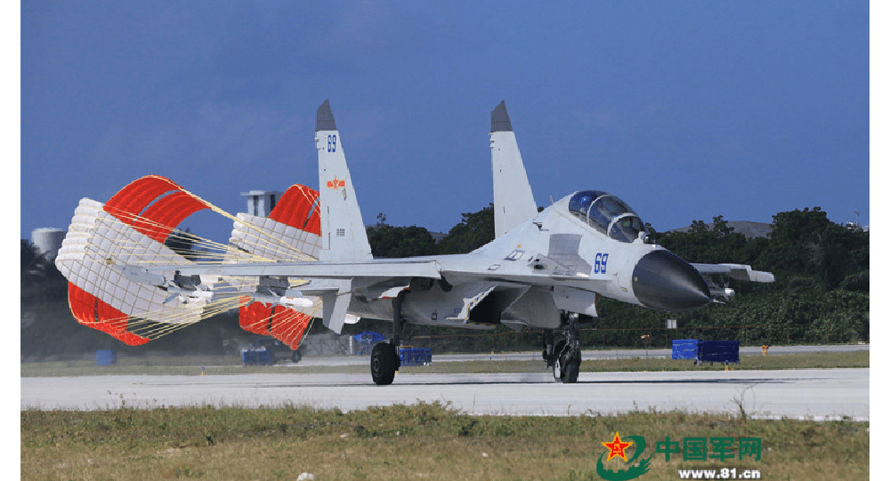 A J-11 fighter taxis on the runway after returning from a flight training on Oct. 30, 2015. An aviation division under the South China Sea Fleet of the Chinese PLA Navy carried out on Friday training on real air battle tactics.