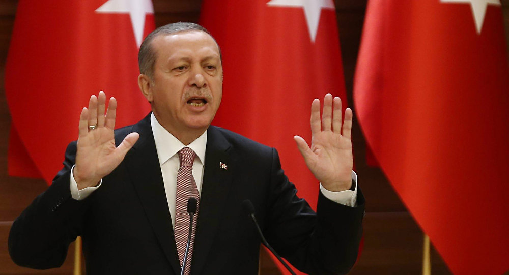 Turkish President Recep Tayyip Erdogan delivers a speech during a mukhtars meeting at the presidential palace on November 26, 2015 in Ankara