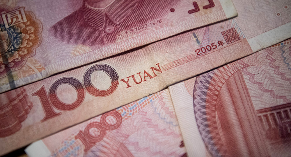 This photo illustration taken on September 29, 2016 shows Chinese 100 yuan notes in Beijing.