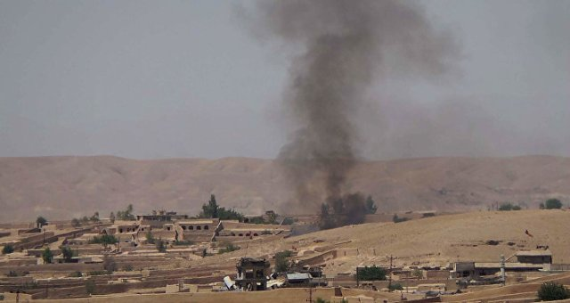 Smoke rises following fighting between the Afghan National Army and Taliban insurgents.