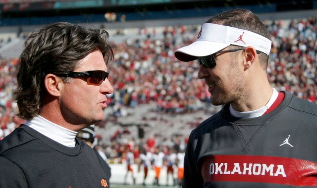 Oklahoma State coach Mike Gundy, left, and Oklahoma coach Lincoln Riley talk before a Bedlam college football game between the University of Oklahoma Sooners (OU) and the Oklahoma State University Cowboys (OSU) at Gaylord Family-Oklahoma Memorial Stadium in Norman, Okla., Nov. 10, 2018.  Photo by Bryan Terry, The Oklahoman