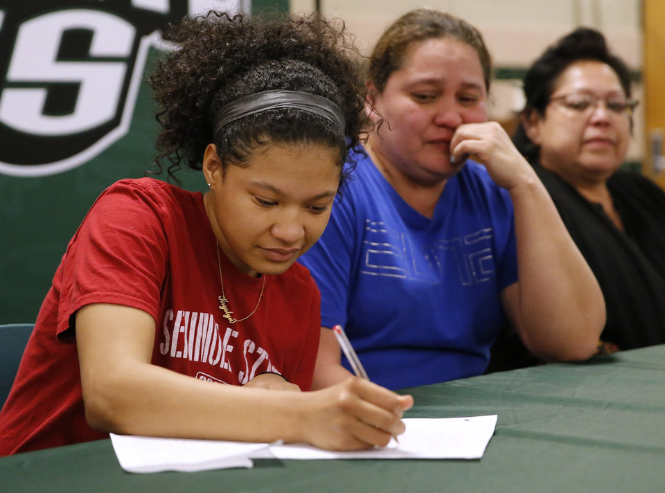 Photo - Kryslyn Jones signs to play basketball with Seminole State as her mom, Kerri Jones, reacts next her during signing day ceremony at Edmond Santa Fe High School in Edmond, Okla., Wednesday, Feb. 6, 2019. Photo by Sarah Phipps, The Oklahoman
