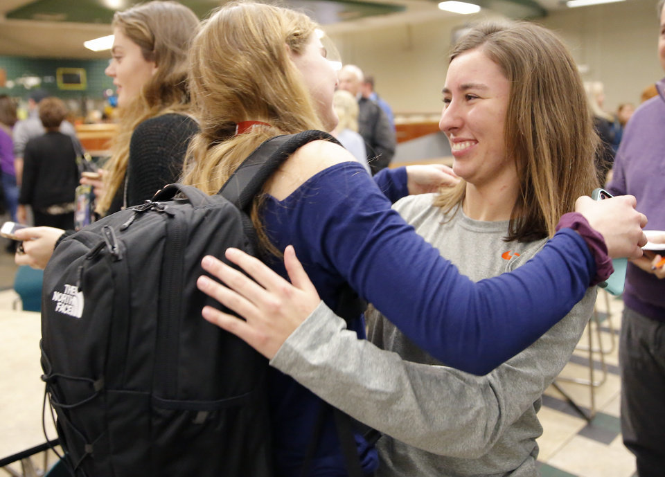 Photo - Catherine O'Keefe, right, hugs Meg Doyle after signing with Clemson rowing during signing day ceremony at Edmond Santa Fe High School in Edmond, Okla., Wednesday, Feb. 6, 2019. Photo by Sarah Phipps, The Oklahoman