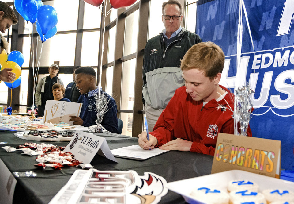 Photo - Edmond North's TJ Rolf signs his letter of intent to play soccer for Oklahoma Christian University during a national signing day ceremony at the school in Edmond, Okla. on Wednesday, Feb. 6, 2019.  Photo by Chris Landsberger, The Oklahoman
