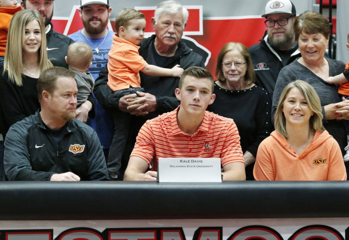 Photo - Kale Davis poses with his family after signing letter to play baseball at Oklahoma State University during Signing Day event at Westmoore High School on Wednesday, Feb. 6, 2019.  Photo by Jim Beckel, The Oklahoman.