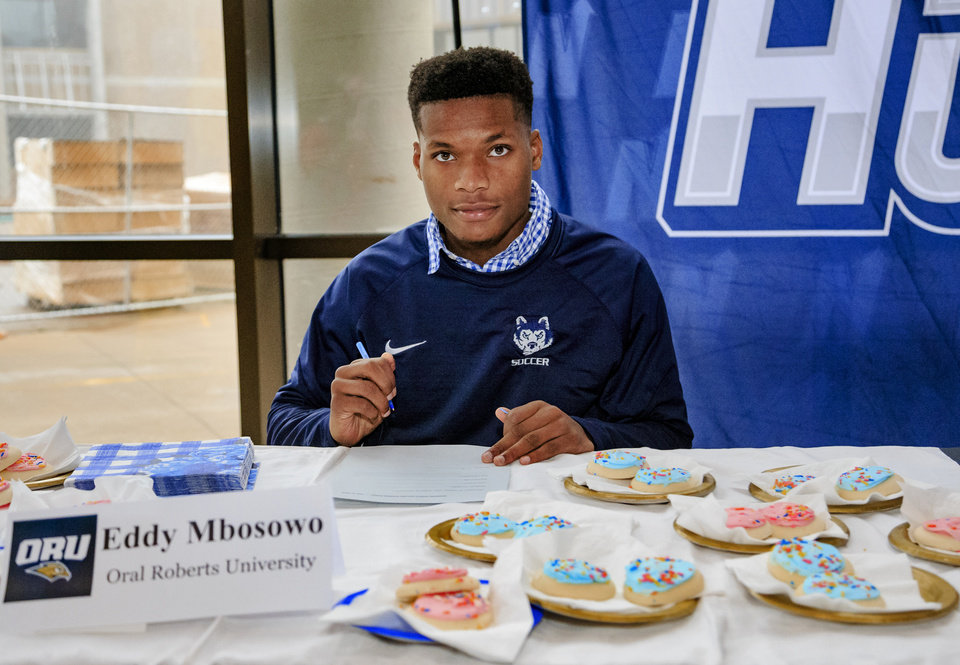 Photo - Edmond North's Eddy Mbosowo prepares to sign his letter of intent to play soccer for Oral Roberts University during a national signing day ceremony at the school in Edmond, Okla. on Wednesday, Feb. 6, 2019.  Photo by Chris Landsberger, The Oklahoman