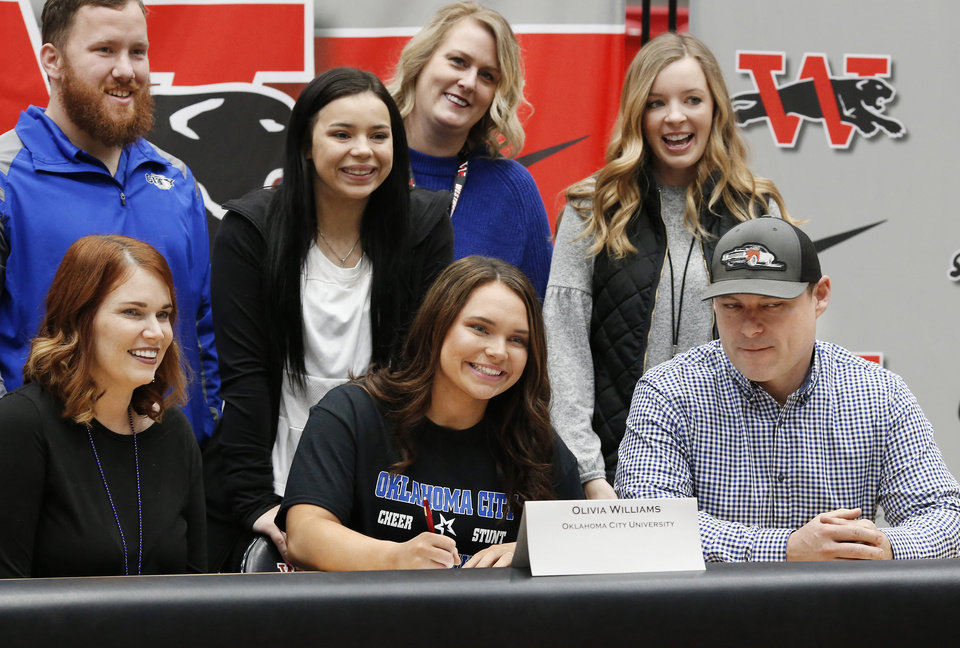 Photo - Olivia Williams signs letter to attend Oklahoma City University during Signing Day event at Westmoore High School on Wednesday, Feb. 6, 2019.  Photo by Jim Beckel, The Oklahoman.