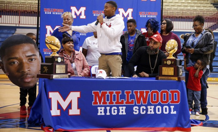 Photo - Millwood's De'Mariyon Houston introduces his family during a signing ceremony for high school football players in the Millwood Field House in Oklahoma City, Wednesday, Feb. 6, 2019. Houston will play football at Nebraska. Photo by Nate Billings, The Oklahoman