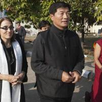 Photo - U.S. Under Secretary of State for Civilian Security, Democracy, and Human Rights Sarah Sewall, left, walks out of the airport with the Tibetan prime minister Lobsang Sangay, second from right, on her arrival in Dharmsala, India, Friday, Jan. 15, 2016. Sewall is scheduled to see the Tibetan spiritual leader Dalai Lama at his residence on Saturday. (AP Photo/Ashwini Bhatia)