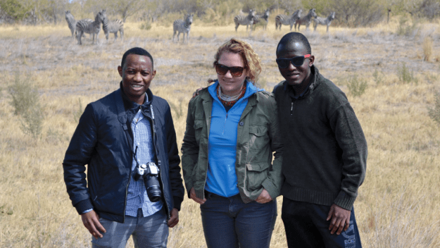 Harvard students Yanick Mulumba and Charlotte Kreger, and friend