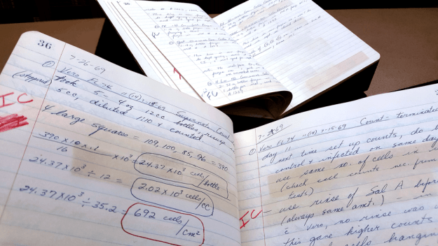 Dr. Max Essex's lab notebooks from 1969 show his groundbreaking work on the mechanism of transmission of feline leukemia.