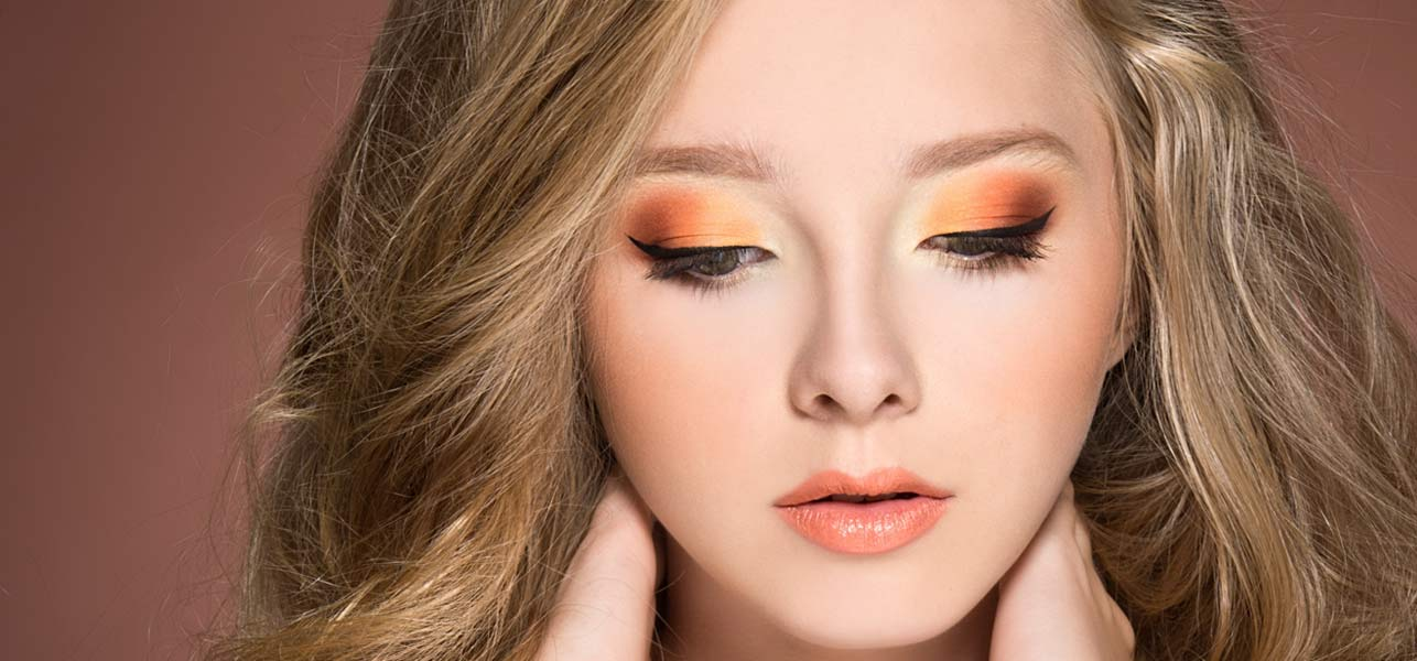 What color eye makeup with orange dress