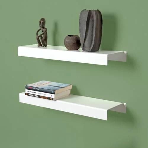 Ci serve spazio perché abbiamo tantissimi libri e qualche oggetto d'arte da esporre. Mensole Design E Mensole A Muro