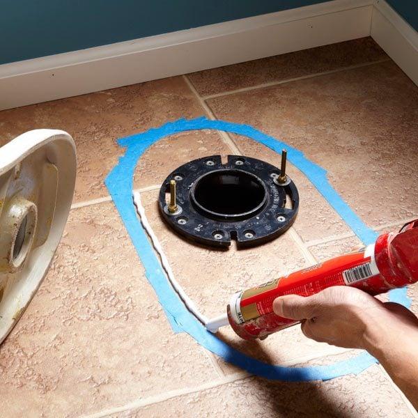 How to Caulk a Toilet to a Floor  The Family Handyman