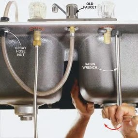 how to repair kitchen faucet bronze faucets replace a the family handyman photo 4 loosen tailpiece nuts with basin wrench