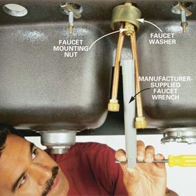 how to repair kitchen faucet inside cabinet lighting replace a the family handyman photo 6 tighten mounting nut