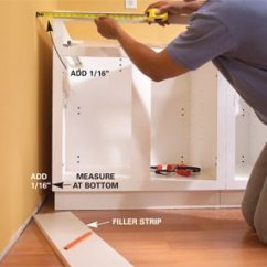 Kitchen Floor Cabinet Industrial Hardware How To Install Cabinets The Family Handyman Photo 4 Measure Gap
