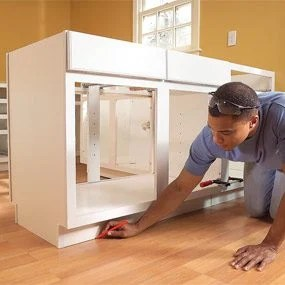 kitchen cabinets set small tv for how to install the family handyman photo 9 mark position of second cabinet