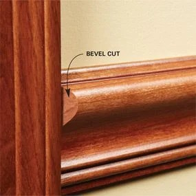 how to put chair rail molding dining covers for sale nz install a the family handyman cut shallow bevel at end when you thick against thin casing