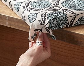 how to reupholster a chair cushion corner painted wood chairs upholster the family handyman photo 8a wrap corners