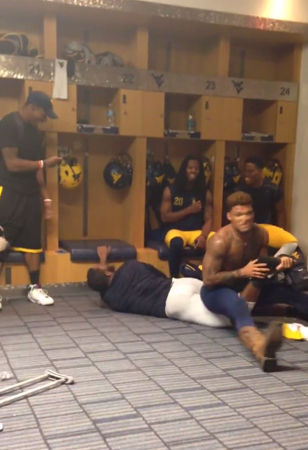 West Virginia players wrestle WWEstyle in locker room