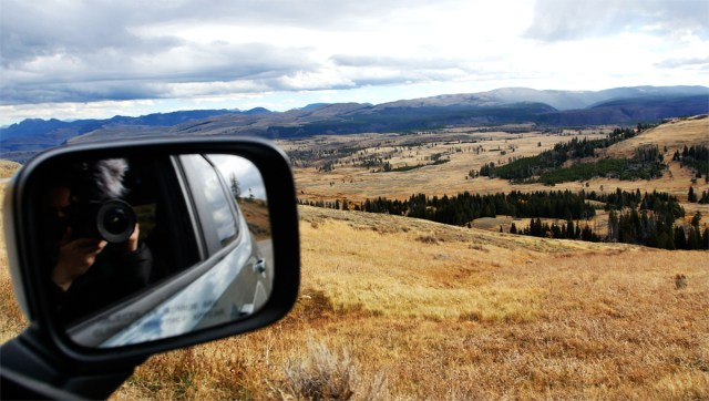 Photograph taken out of the passenger side of the landscape, you can see the camera in the side view mirror.