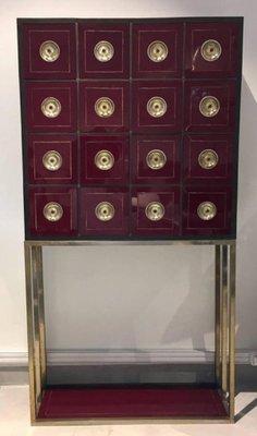 meuble de rangement vintage couleur bordeaux avec 16 tiroirs