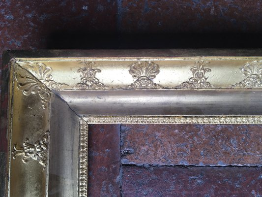antiqued gilded frames with