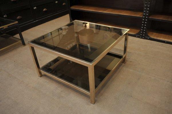 table basse vintage en verre fume et en metal de belgochrom annees 70