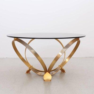 table basse ronde avec anneaux geometriques en laiton et plateau en verre par knut hesterberg 1970s