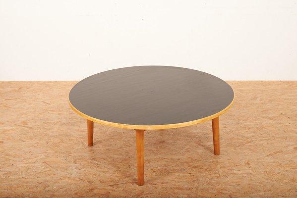 mid century swiss wood and black linoleum coffee table