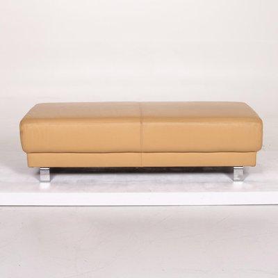 beige leather ottoman from ewald schillig