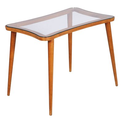 mid century modern coffee table with glass top in the style of ico parisi