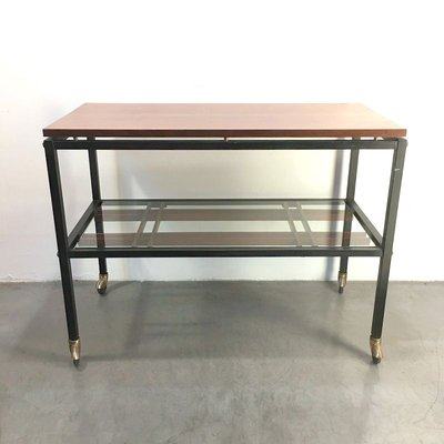 mid century glass coffee table on wheels from zuenelli