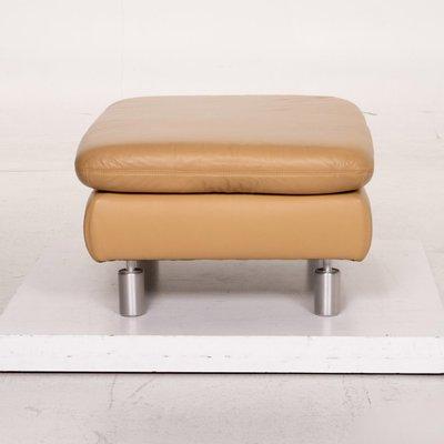 beige leather ottoman