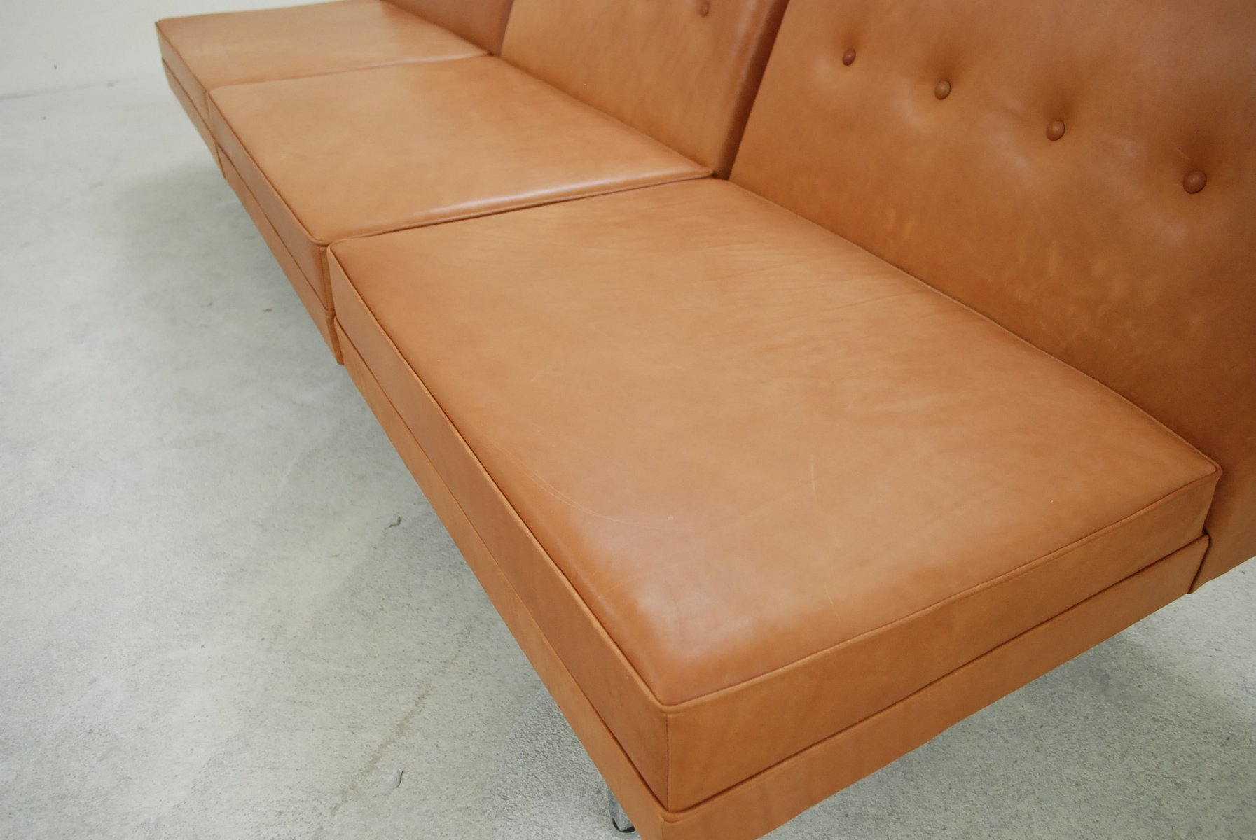 herman miller modular sofa coaster chenille sleeper with storage cognac leather set by george nelson for