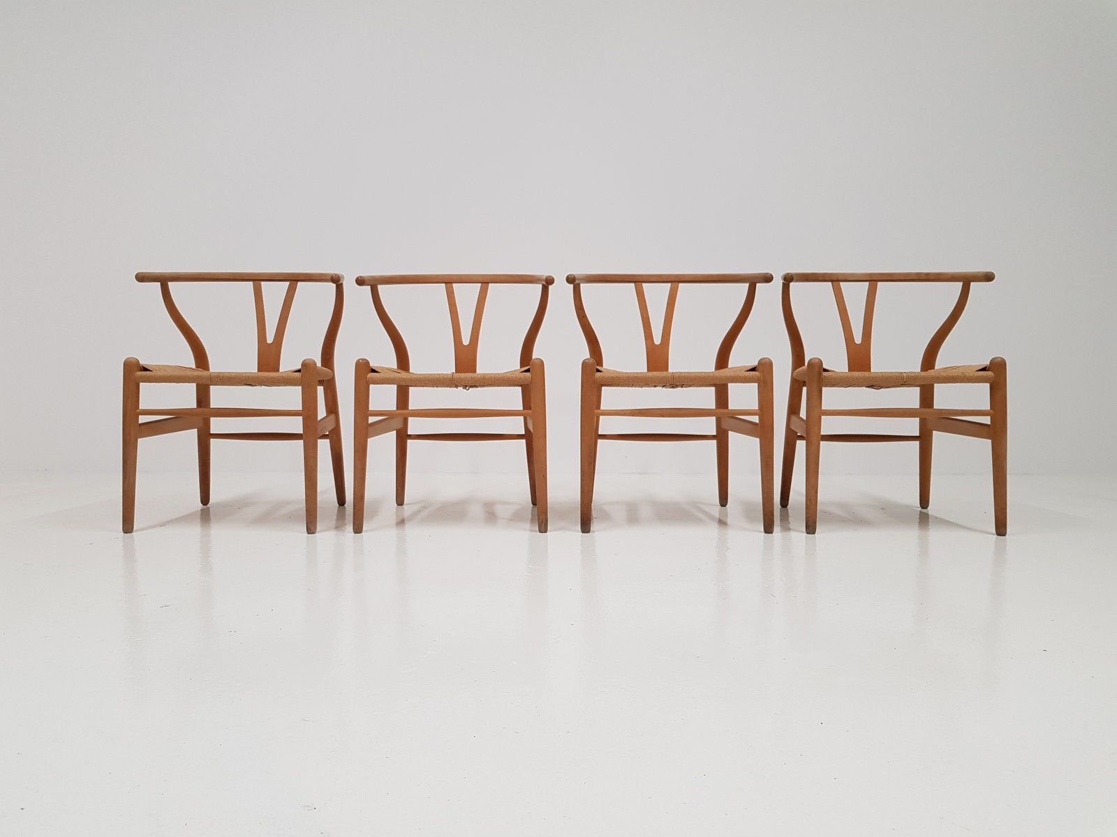 Wishbone Chairs Ch24 Wishbone Chairs By Hans J Wegner For Carl Hansen Søn Set Of 4