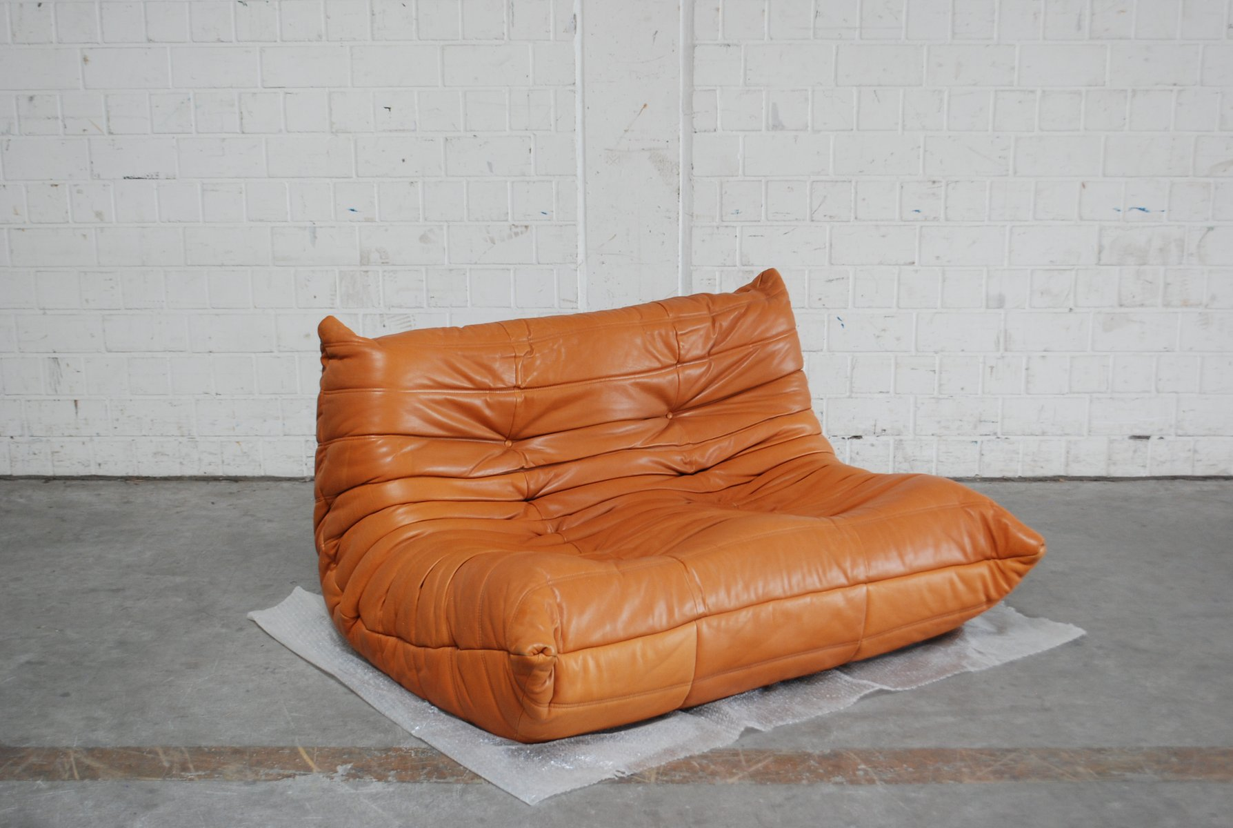togo sofa price cheap black corner uk in cognac leather by michel ducaroy for ligne