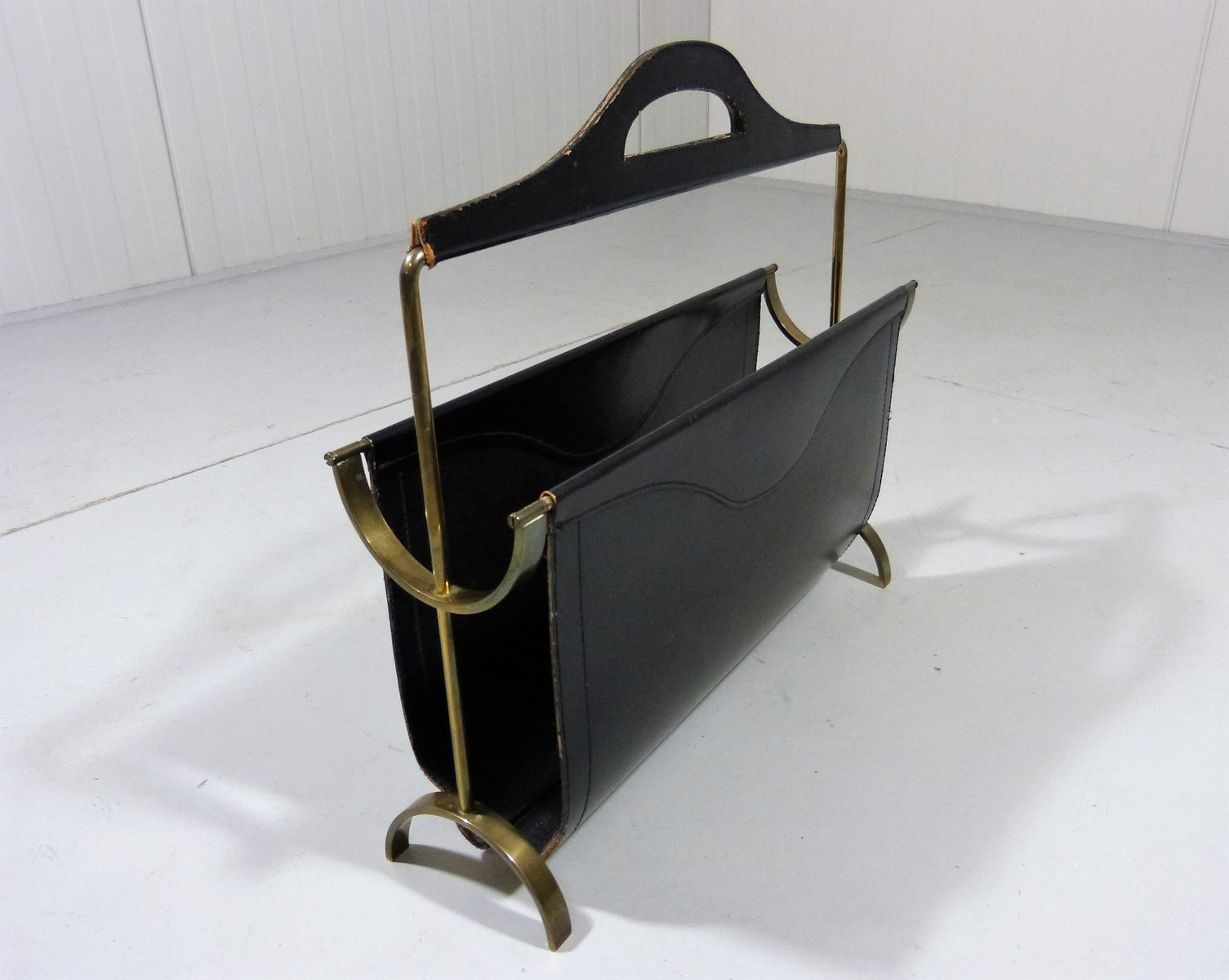 black leather and brass magazine rack 1950s