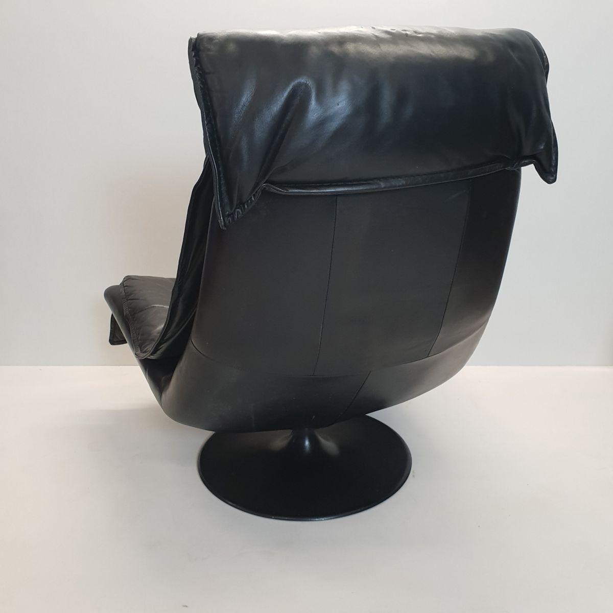 black leather swivel lounge chair modern stacking chairs large vintage with