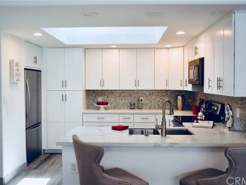 kitchen upgrades with pantry cabinet we love this seal beach starter home white 0