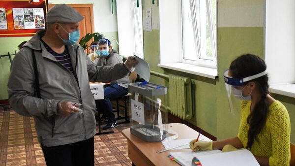 A man voting at a polling station on amendments to the Constitution of the Russian Federation in Vladivostok