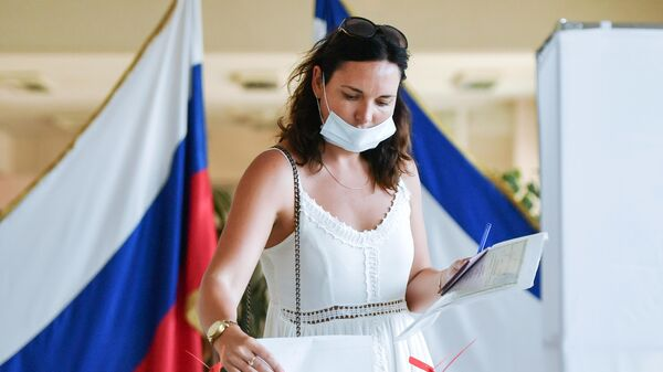 A woman takes part in the vote on amendments to the Constitution of the Russian Federation at one of the polling stations in Simferopol