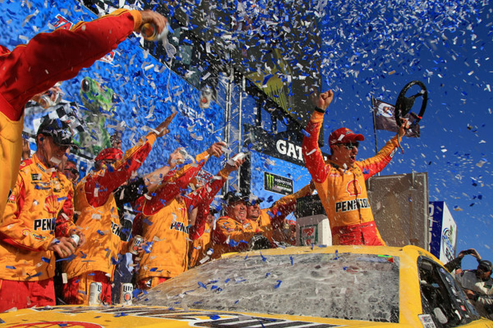 Joey Logano, driver of the No. 22 Shell Pennzoil/Autotrader Ford, celebrates in Victory Lane after winning the Monster Energy NASCAR Cup Series GEICO 500 at Talladega Superspeedway on April 29, 2018 in Talladega, Alabama. (Photo Credit: Daniel Shirey   Getty Images)