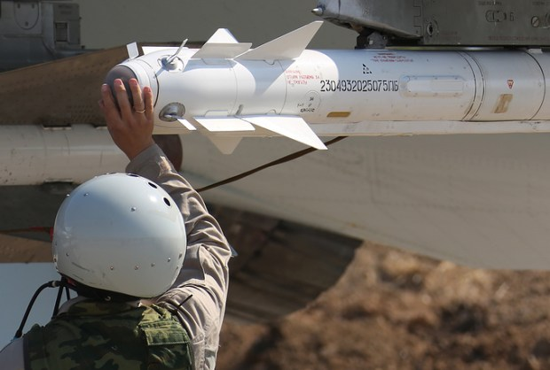 Russian serviceman loading an R-73 missile